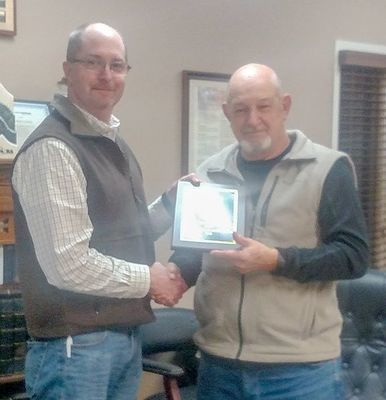 Superintendent Casey Henderson presenting Allen Kyle a plaque to recognize 27 ½ years on the Hickman County Board of Education.  (Photo by Becky Meadows)