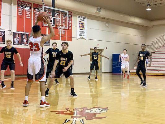 Red Devil Blake Johnson ponders a shot in action versus Halls last week. (Photo by Jake Clapper)