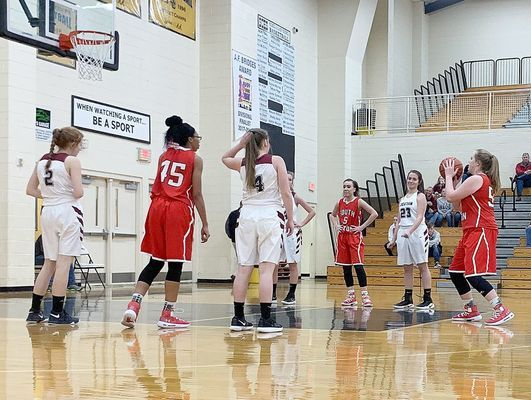 Lady Red Devil Sophia Hodges toes the line, for one of her six points scored during the Stewart County Christmas tournament, with both the SFHS boys' and girls' teams participating. (Photo by Jake Clapper.)
