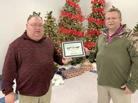 ETHERTON RECOGNIZED – Fulton County Transit Authority Executive Director Kenney Etherton was recognized by Paul Maxwell, Human Resources/Safety Director, for seven years of service to FCTA, during the Dec. 20 awards banquet held at Fulton's Pontotoc Community building in Fulton. Lynn Lewis, Billing Clerk, was honored for six years of service, but was not pictured. Door prize winners during the evening's banquet included Kenny Patterson, Mechanic, Sherry Smith, Driver, Linda Morris, Custodian, Gary Blair, Driver and Lauren Caksackkar, Billing Clerk.(Photo submitted.)