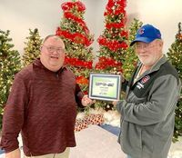 FCTA EMPLOYEE FOR 13 YEARS – Mike Lowe, Facility Groundskeeper for Fulton County Transit Authority, was recognized during the FCTA awards banquet Dec. 20, for his 13 years of service with FCTA. He was honored by Executive Director Kenney Etherton. (Photo submitted. )
