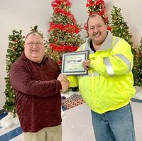 SIX YEARS OF SERVICE – Mike Reilly, Driver for Fulton County Transit Authority, was recognized by FCTA Executive Director recently, for his six years of service. Reilly was recognized during the Dec. 20 awards banquet. (Photo submitted. )