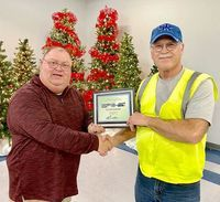 DRIVER HONORED – Roger Barnes, a Driver for Fulton County Transit Authority for six years, was recognized by FCTA Executive Director Kenney Etherton, and honored during the Dec. 20 awards banquet.