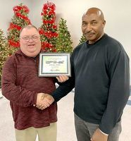 OVER TWO DECADES OF SERVICE – Sam Jones, a Driver with Fulton County Transit Authority for 26 years, was recognized for his service by FCTA Executive Director Kenney Etherton during the recent awards banquet. (Photo submitted. )