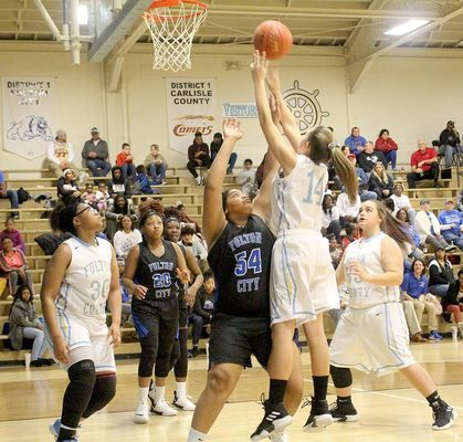 TWO POINTS - Fulton County's Rhiannon Eakes (14) puts in a shot over Fulton City's Mia Martin (54) during their game in Hickman last week. Eakes scored four points and had seven rebounds, but the Lady Bulldogs posted a 54-28 district win. (Photo by Charles Choate)