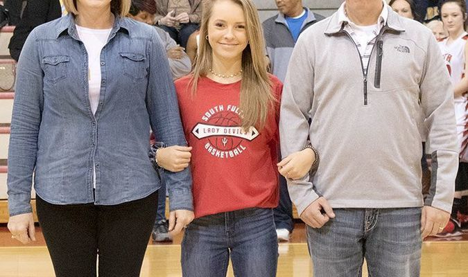 SFMS EIGHTH GRADE RECOGNITION NIGHT – Lilly Holzner, SFMS Lady Red Devil basketball team member and her parents, Tara and John Holzner, were honored last week during the South Fulton Middle School Basketball Eighth Grade Night recognition ceremony.