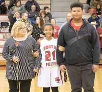 SFMS BASKETBALL EIGHTH GRADE NIGHT – Shaylynn Brown, a member of the South Fulton Middle School Lady Red Devils basketball team, accompanied by her mother, Traci Ramsey, and Jordan Brown, were recognized during Eighth Grade Night at SFMS gym last week.