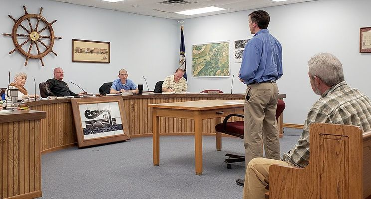 UNDER NEW MANAGEMENT – The City of Hickman Water Plant and Wastewater Plant are under new management effective Feb. 1, under Alliance Professional Water and Wastewater Operations of Missouri. Standing, Tim Geraghty, President of Alliance spoke to Commissioners on Jan. 30 about plans Alliance has for the city water system. A crew was coming to town Feb. 1 to find leaks, with another crew to be in town Feb. 4 to start repairing the leaks. (Photo by Barbara Atwill)