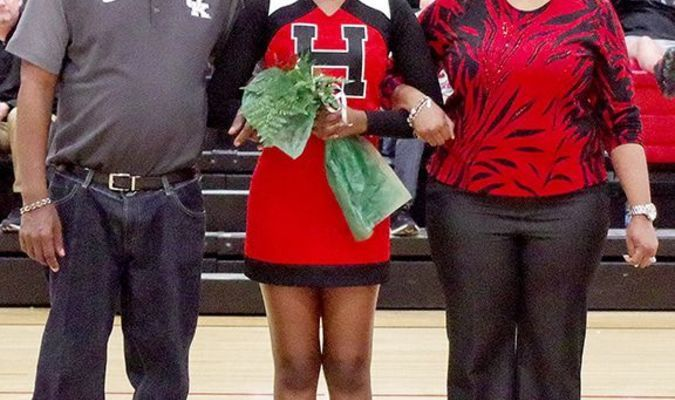 SENIOR CHEERLEADER RECOGNIZED – Makayla Hardin, along with her parents, Jarvis and Paulette Wilson, were recently honored during Hickman County High School's Senior Night. (Photo by Becky Meadows)