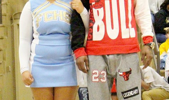 SENIOR FCHS CHEERLEADERS SPOTLIGHTED – Fulton County High School celebrated Senior Night Feb. 1 in Hickman. 10 basketball players and cheerleaders were honored during pre-game ceremonies. Fulton County cheerleader Kanisha Wooten was escorted by her father, Daz Fitz. (Photo by Charles Choate)