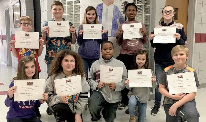 top students at hces – Hickman County Elementary School recently recognized its Students of the Month for February. The character trait emphasized in February was Show Respect to Myself and Others. To correlate with Black History Month, students are shown with research projects completed by HCES fifth and sixth grade students regarding famous African-Americans and their achievements. Intermediate Students of the Month for February are pictured with Garrett Morgan, an African American and native Kentuckian famous for many inventions, including the traffic light and gas mask. Intermediate students honored in February include, front row, left to right, Kyleigh Sanders, Kenzie Crumble, Jerrek Alexander, Kylie Hurt, and Jacob Mann; back row, Elijah Summers, Clayton Gilliland, Brooklyn Kennedy, Marquan Alexander, and Lilly Kimbell. (Photo submitted)