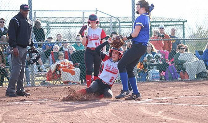 SLIDE RIGHT IN – South Fulton Lady Red Devil Amber Lemon stirred up some dirt at home, to score the first run of the 2019 high school softball season. The score was off a triple, hit by team mate Marli Buchannon. (Photo by Jake Clapper.)