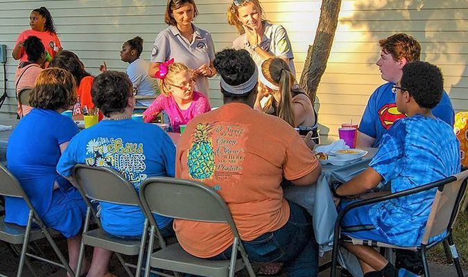 HEALTHY HICKMAN COUNTY HAPPENINGS – Kaitlyn Krolikowski and Cynthia Turner encouraged everyone to look for a way that they can improve their community at the community garden groundbreaking at Henley Park Apartments in Clinton July 10. (Photo by Becky Meadows)