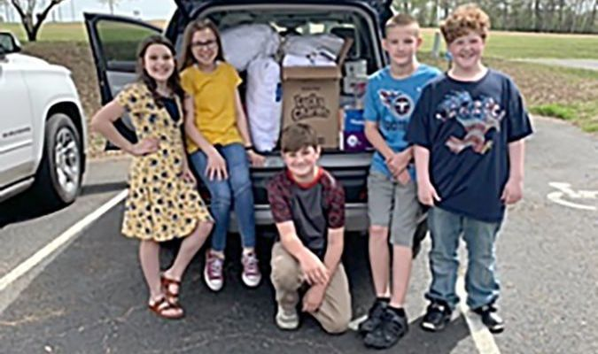 Pictured are some of the SFE Beta members loading the items in Johnnie Cloar's car to be delivered as well as some of the Harrah's Hope Lodge staff members with the items. (Photo submitted)
