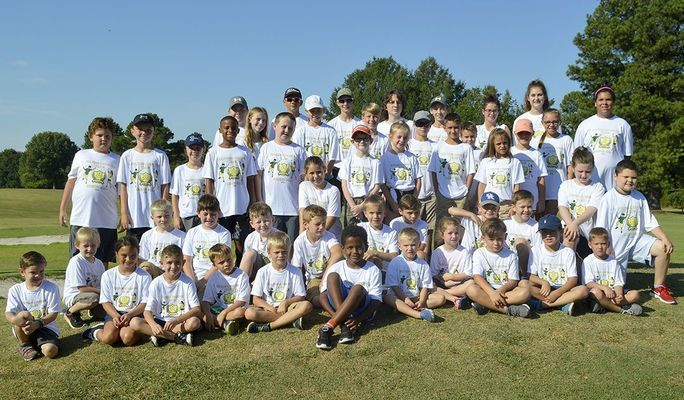 JUNIOR GOLF PARTICIPANTS – This group of over 50 kids participated in the final round of the Junior Golf program offered at the Fulton Country Club July 27. A total of 80 children over the course of seven weeks learned the basics of the game of golf. (Photo by Benita Fuzzell)
