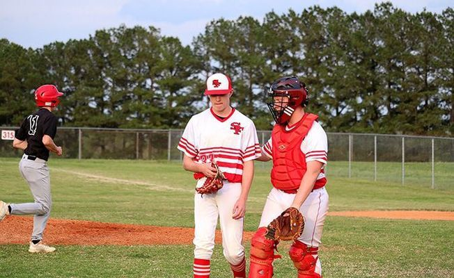 South Fulton High School Red Devils Bryce McFarland and Garrett Slaughter discuss strategies during baseball action last week, as the Devils suffered two losses, at the hands of Hickman County and Bradford. (Photo by Jake Clapper.)