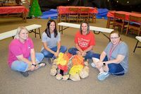 """South Fulton Elementary teachers Laura Murphy, Christa Hankins, Amanda Wilder and Penny Burton gather around the """"campfire"""" created in the SFES library for the Read To Be Ready Summer grant funded reading program, """"Camp Reel"""", running through June. (Photo by Benita Fuzzell.)"""
