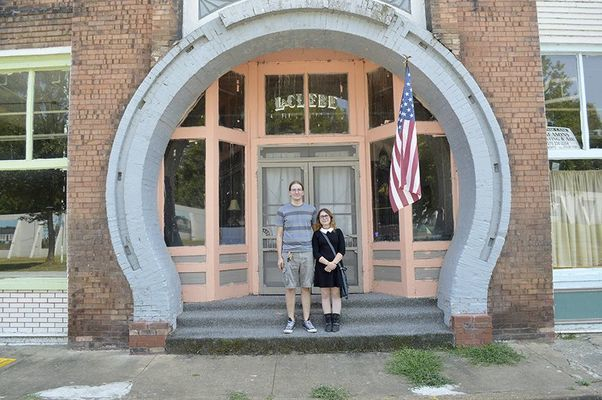 NEW LIFE FOR LACLEDE – Antti Williams and Heather Sidberry of Tampa, Fla., stand in front of the LaClede Hotel in downtown Hickman. Williams has bought the LaClede and plans to have it in operation for the holidays in 2019. (Photo by Barbara Atwill)