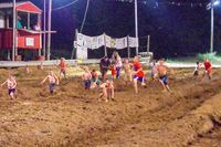 "GOOD, ""CLEAN"" FUN AT THE FAIR – Following the mud races Aug. 4, the kids in attendance at the fair had a foot race down the track at the Hickman County Fair grounds. (Photo by Becky Meadows)"