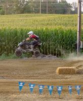 DIRT, DIPS AND DRIVING AT THE HICKMAN COUNTY FAIR – Dirt bikes in the TT races were a popular event last week, as participants raced in high gear Aug. 2 at the Hickman County Fair in Clinton. (Photo by Becky Meadows)
