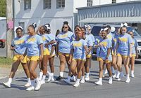 CHEERING FOR EIGHTH OF AUGUST – Members of Fulton County Middle School Cheerleaders participated in the Eighth of August Parade held in Hickman on Aug. 4. The Cheerleaders walked and cheered as they traveled down Moscow Ave. and South Seventh St. Activities continued Aug. 6 with School Supplies being given away at Jeff Green Memorial Park. (Photo by Barbara Atwill)