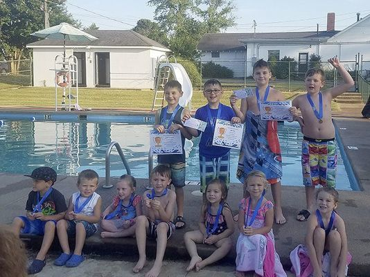 safe swimmers – Pictured are the July 23-27 Swim Class Level 1 participants, left to right, Emmett Weatherford, Ward Burnette, Allison Lindsey, Raden Lux Woodruff, Molly Linder, Katie Grace Joyner, Maci Jo Pyle; back row, Levi Simpson, Jake Foy, Isaac Simpson, and Vinn Lowry. Instructors Ann Bard and Sharye Hendrix taught the class at the Fulton Country Club. (Photo submitted)
