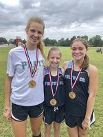 VARSITY GIRLS MEET – Fulton County runners Marlena Sipes, left, finished 10th, Emma Madding, center, 20th place, and Callie Coulson, right, 21st, participated in the Calloway County Invitational held Sept. 8 at Calloway County High School. (Photo submitted)