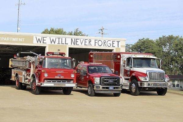 """9/11 TRIBUTE – South Fulton Fire Department personnel paid tribute to first responders and emergency crews who lost their lives during the 9/11 attacks in 2001 by posting a sign noting """"We Will Never Forget"""". (Photo submitted)"""