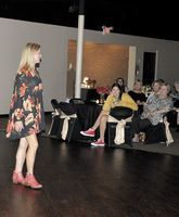 DINNER AND A SHOW – A packed house was on hand for the 2018 Banana Festival Fashion Show which featured dozens of fashion selections for men, women, children and pets, as well as a catered dinner and entertainment. (Photo by Benita Fuzzell)