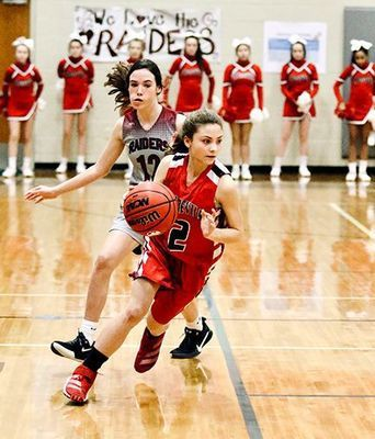 LADY RED DEVIL ON THE RUN – South Fulton Middle School's Aubree Gore outruns and outguns a sectional tournament opponent, with a win assuring her team of a state tournament appearance this Friday. (Photo by Jake Clapper)