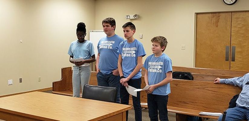 REQUESTING CITY'S HELP – Fulton County Middle School's Young Leaders in Action (YLA) attended the Hickman City Commission Feb. 24. The YLA asked about creating an ordinance for homes in Hickman to place numbers for emergency personnel, including EMS, fire, and police. Pictured from left are Amareese Esters, Connor O'Malley, Daniel Collins, and Logan Griffiths. Beth McWhirt, not pictured, is the advisor for YLA. (Photo by Barbara Atwill)