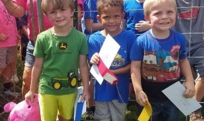 Pre-School Greased Pig contest winners -- Gavin Adams, Jamal Piro and Gunner Elliott were the winners in Saturday's Banana Festival Greased Pig contest, in the Pre-school age group.