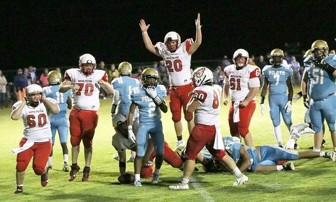 THAT'S A WINNER – South Fulton's Eli Carlisle (20) gives the signal, after Mason Harper scored the game winning touchdown over Fulton County last Friday night. After a scoreless four quarters, Harper's overtime score gave the Red Devils a 6-0 win at Sanger Field. (Photo by Charles Choate)