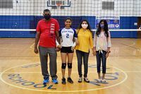 Senior Hannah Patel was escorted by Naresh Patel and Tejal Pate. (Photo by Benita Fuzzell)