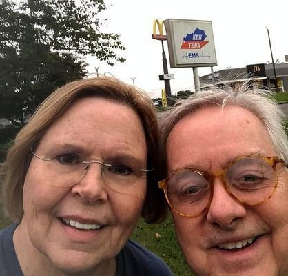 """HOT ON THE HUNT – Two of the Chamber Scavenger Hunters, Bob and Brenda Mahan, """"check-in"""" on Facebook at one of the clue locations. (Photo submitted)"""