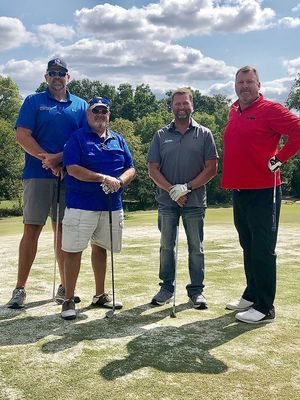 SUITED TO A TEE – Premier Portable Buildings, with team members Tim Franklin, Michael Franklin, Greg Hodges and Michael Don Burnette, took second place in the Twin Cities Chamber Annual Golf Tournament at Fulton Country Club on Friday. (Photo submitted)
