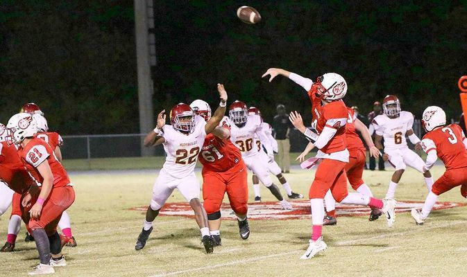 Humboldt's Isaiah Agnew (22) tries to defend a pass by South Fulton quarterback Bryce McFarland (4), during the first quarter of play last Friday night. McFarland threw touchdown passes to Rider Whitehead and Beau Britt, and helped guide the Red Devils to a 20-8 Homecoming win over the Vikings. (Photo by Charles Choate)