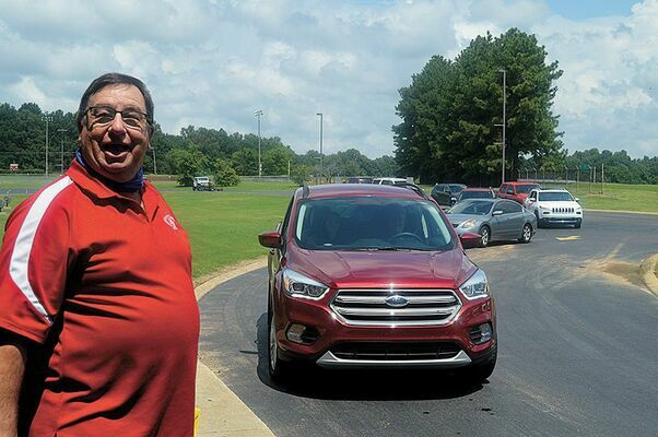"""HISTORICAL TEACHER RETIRES – Longtime South Fulton teacher Bill Gray, after 43 years in the classroom, most often teaching history, chose to retire in 2020, with faculty, friends, family and former and current students honoring him with a """"drive-through"""" tribute at the front entrance of SFMS/SFHS. Gray was featured in the Aug. 19 Current."""