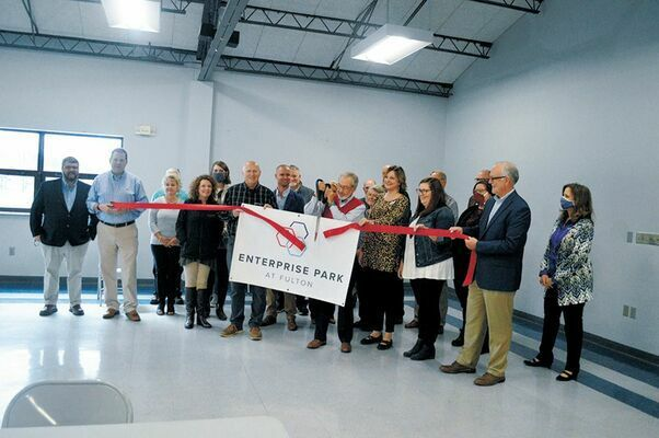 BRANDED – Community leaders and officials were on hand Oct. 20 for a ribbon cutting to unveil the new name and logo, Enterprise Park at Fulton, formerly known as Fulton Industrial Park, as shown in this photo published in the Oct. 21 edition of The Current.