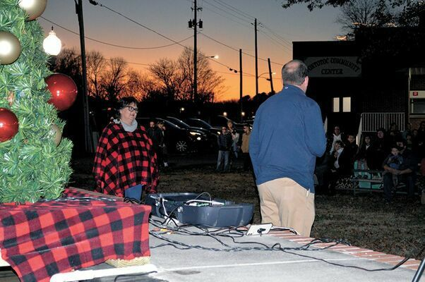 CHRISTMAS IN THE PARK – Although modifications were made, including Santa socially distancing in the gazebo to visit with children and the T.C.M.O. chili supper pre-packaged, to-go, Christmas in the Park, sponsored by Fulton Tourism Commission was celebrated Dec. 5, and featured in the Dec. 9 edition of The Current, as the Twin Cities Chamber Citizen of the Year, Darcy Linn, pulled the switch to illuminate the community Christmas tree.