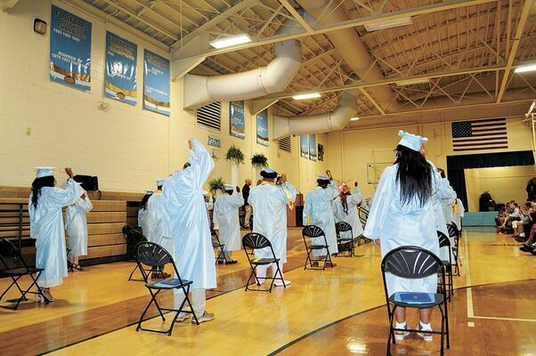 SPACED OUT FOR A SPECIAL CELEBRATION – Members of  the Fulton County High School Class of 2020 were able to participate in graduation ceremonies in their respective gyms, albeit in a socially distanced manner, with immediate family also present, seated in the bleachers. The  FCHS graduation, in the June 3 edition.