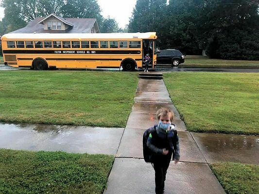 INAUGURAL BUS RIDE –  Fulton Independent students made history, shown in this photo appearing in the Oct. 14 edition of The Current, utilizing the district's newly established door to door bus transportation to and from school campuses.
