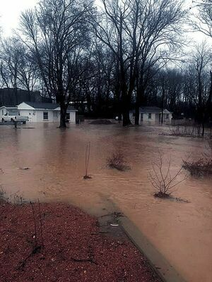 FLOODS AND OVERFLOW – The Twin Cities were pounded with torrential Summer rainfall, resulting in flooding throughout areas of Fulton and South Fulton, as shown in this photo published in the June 15 Current.