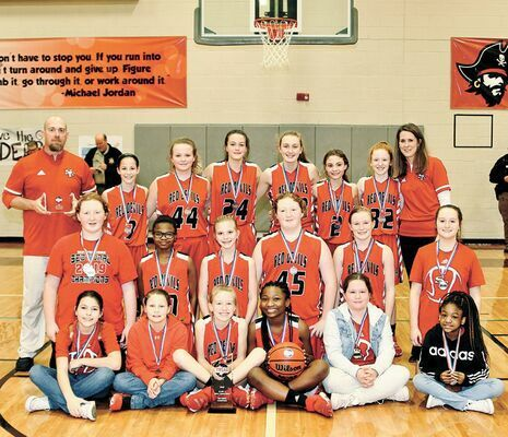 STATE BOUND – South Fulton Middle School Lady Devils and Coaches Jeremy McFarland and Leah McFarland, featured in the Feb. 12 edition of The Current, captured a sectional crown Feb. 10, advancing to the Tennessee Middle School Athletic Association State Class A Tournament.