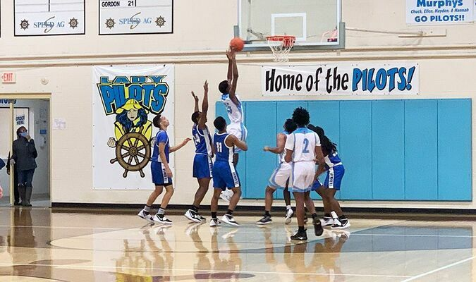 Fulton County High School Pilot Omarion Pierce soars high to pull down one of his four rebounds when the Pilots hosted the Paducah Tilghman Blue Tornadoes Jan. 15. (Photo by Mark Collier)