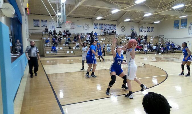 Fulton County High School Lady Pilot TaKyiah McNeal calls for teammate Callie Coulson to lob her a pass during the Lady Pilots' season opening game against Paducah Tilghman Jan. 15. (Photo by Mark Collier)