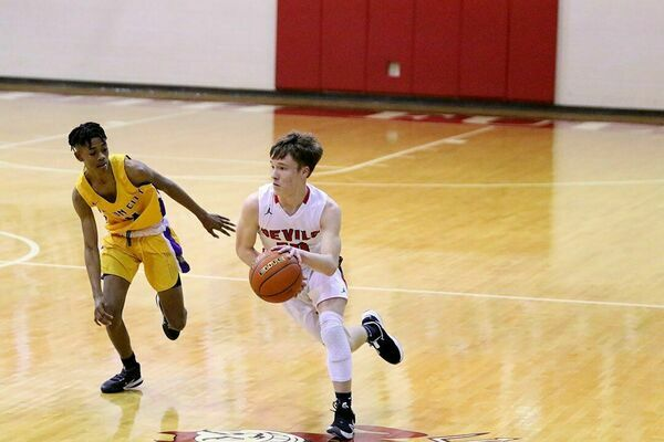 South Fulton Red Devil Drew Barclay chipped in two points against Union City's Tornadoes, a game which resulted in a seven point deficit for the Devils, and a UC win, 67-60. (Photo by Jake Clapper)