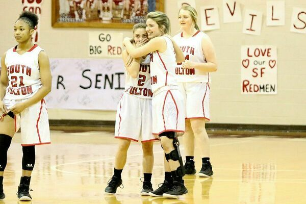 SFHS Lady Red Devil senior Halle Gore hugged her younger sister and team mate, Anna Gore during Senior Night Feb. 9. It was the first time this season the two had been able to take the floor at the same time, as Halle Gore, due to a knew injury, has not been able to participate in her senior year of play. (Photo by Jake Clapper)