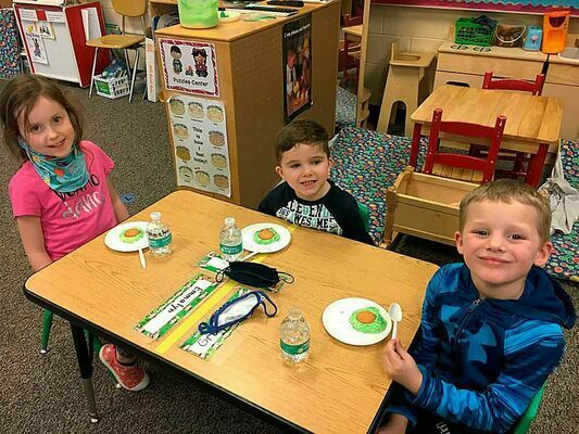 South Fulton Elementary School's Preschool class took the opportunity during last week's celebration of all things reading and Dr. Seuss to try out a popular treat worthy of Cat In The Hat cuisine, Green Eggs and Ham, sweetened up with sprinkles and a wafer cookie.
