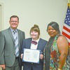HOSA NATIONAL COMPETITOR – Following her Third Place Award at the Health Occupations Students of America (HOSA), Abigail Bittenbender will travel to Dallas, Texas to compete in the International competition. Bittenbender was recognized for her outstanding work at the Fulton County Board of Education meeting on May 24. From left, Superintendent Aaron Collins, Bittenbender, and Fulton County Board of Education Chairperson Kim Hagler. (Photo by Barbara Atwill)